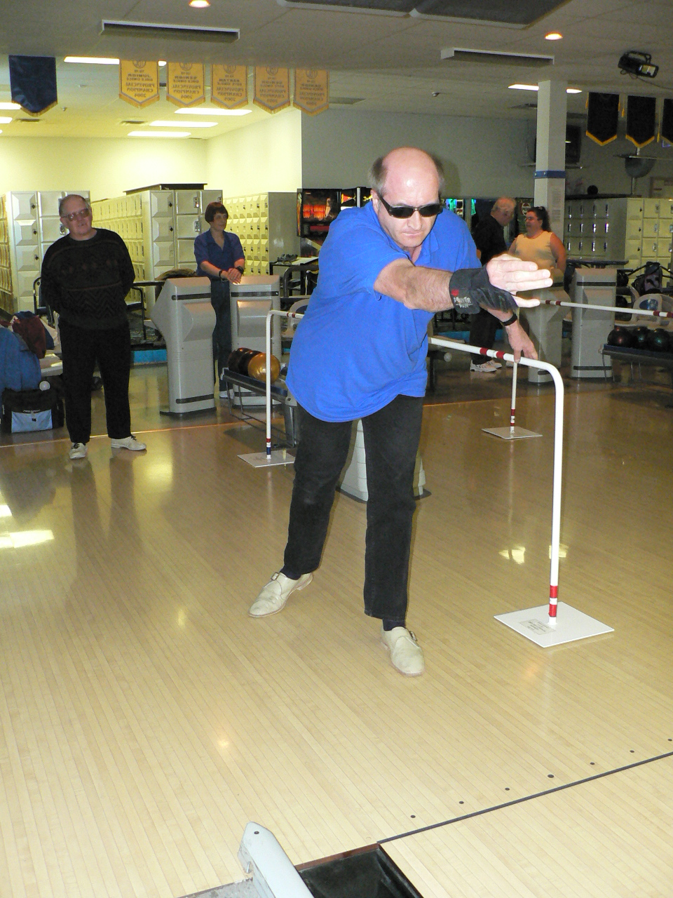 totally blind bowler using guide rail to bowl