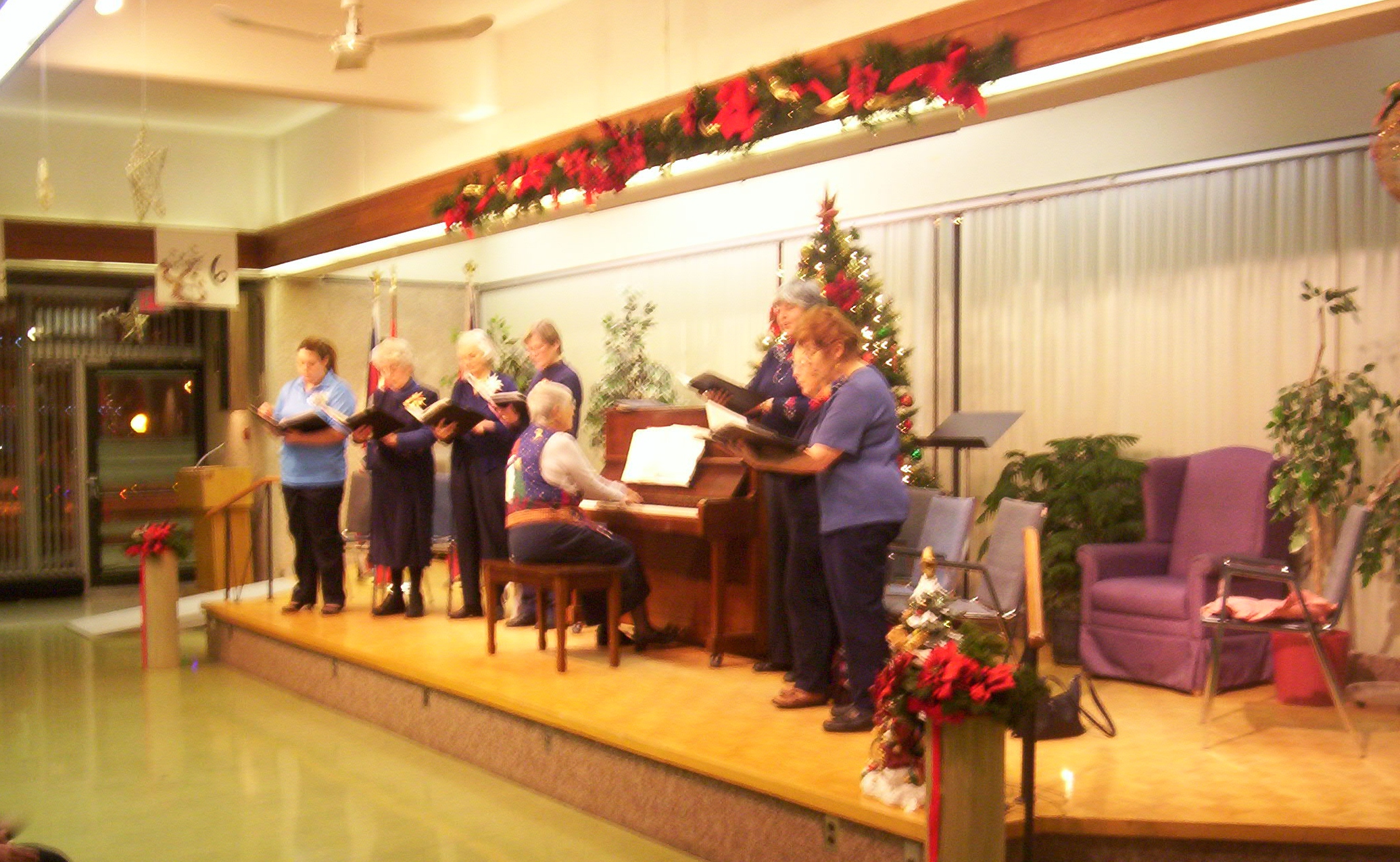 photo of a choir and piano player