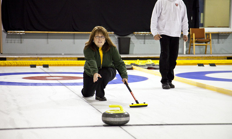photo of VI curler sliding out on the ice