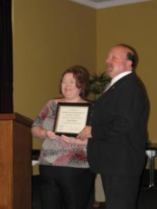 photo of Vic receiving award from Minister Jennifer Howard