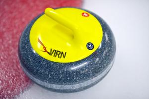 Photo of yellow curling rock with our VIRN Logo on the handle.