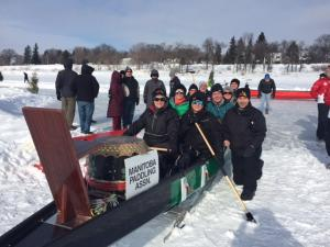 Photo of ten people sitting in a ice dragon boat.