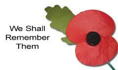 Photo of a red poppy with the words We Shall Remember Them on the left.